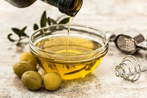 bowl of olive oil, a healthy fat source, home remedies for constipation