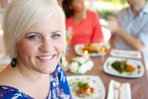 Woman standing by a picnic table. Importance of a dietitian after bariatric surgery.