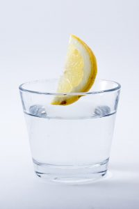 A glass of water with lemon. Nutrition after bariatric surgery.